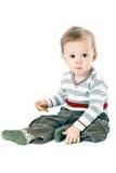 Petit garçon dans le pull de bande photographie stock libre de droits