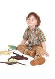 Petit garçon de sourire avec ses jouets Images libres de droits
