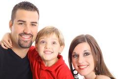 Petit garçon effectuant le visage drôle pour la verticale de famille Images stock