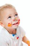 Petit garçon en peinture Photographie stock