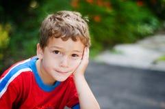 Petit garçon ennuyé Photographie stock libre de droits