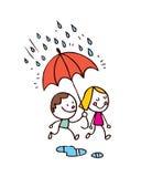 Petit garçon et fille sous la pluie Photos stock