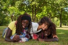 Petit garçon et ses soeurs d'adoption Photo libre de droits