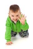 Petit garçon faisant la pose fâchée de tigre Images stock