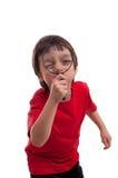 Petit garçon jouant avec la loupe sur le fond blanc Photographie stock libre de droits