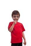 Petit garçon jouant avec la loupe sur le fond blanc Photo libre de droits