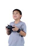 Petit garçon jugeant une radio à télécommande pour l'hélicoptère, bourdon Photo stock