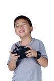 Petit garçon jugeant une radio à télécommande pour l'hélicoptère, bourdon Image stock