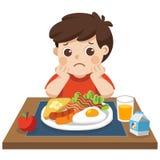 Petit garçon malheureux pour manger le petit déjeuner illustration stock
