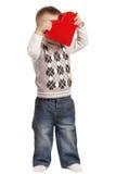 Petit garçon mignon avec le rouge entendu Photos stock