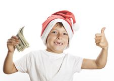 Petit garçon mignon dans le chapeau rouge de Santa d'isolement avec Photos stock
