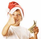 Petit garçon mignon dans le chapeau rouge de Santa d'isolement avec Images stock