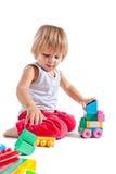 Petit garçon mignon jouant avec des jouets Photo stock