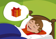 petit garçon mignon rêvant du cadeau d'anniversaire illustration stock