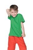 Petit garçon riant images stock