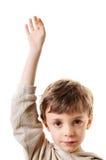Petit garçon soulevant la main Photographie stock libre de droits