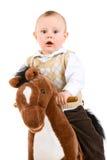 Petit garçon sur le cheval Photos stock