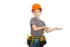 Petit garçon d'ouvrier effectuant la présentation Image stock