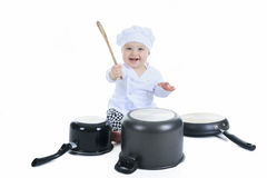 Petit garçon mignon de cuisinier devant un blanc Photos libres de droits