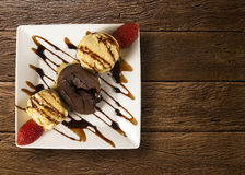Petit gateau dessert with ice cream and strawberry on wooden bac Royalty Free Stock Photography