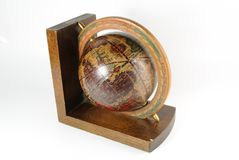Petit globe de serre-livres image stock