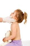 Petit gosse aux médecins Image stock