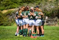 Petit groupe de rugby du ` s de femmes photo stock