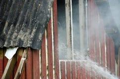 Petit incendie dans une maison Image libre de droits