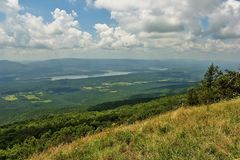 Petit Jean River Valley. And Blue Mountain Lake from Mount Magazine, Paris, Arkansas, USA. It`s Arkansas`s highest point. This is the hang glide and Rock stock photography