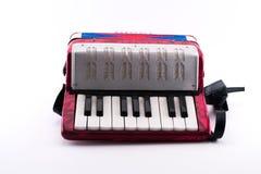 Petit jouet richement coloré d'accordéon photographie stock