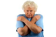 Petit morceau aîné triste de femme ses bras croisés Photographie stock libre de droits