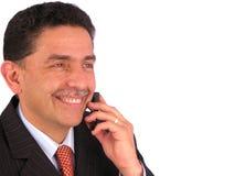 Petit morceau d'homme d'affaires un téléphone portable Images libres de droits