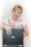 Petit morceau de femmes l'ordinateur portatif Photographie stock libre de droits