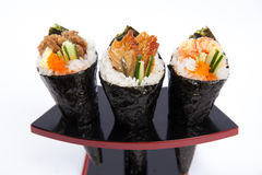 Petit pain assorti Temaki de main Photo libre de droits