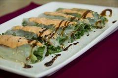 Petit pain avec des poissons d'anguille Photos libres de droits