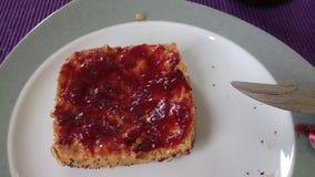 Petit pain avec le marmelade Images stock