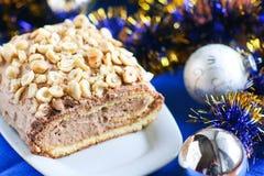 Petit pain de Noël avec les écrous et la crème image stock