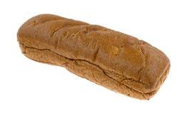 Petit pain de sous-marin de blé entier sur un fond blanc Images libres de droits
