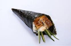 Petit pain grillé Temaki de main d'Unagi Images stock