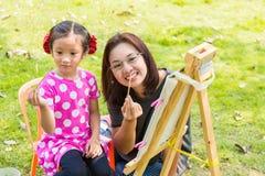 Petit painitng asiatique de fille Images libres de droits