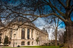 Petit Palais in a cloudy winter day just before spring. PARIS, FRANCE - MARCH, 2018: Petit Palais in a cloudy winter day just before spring stock images