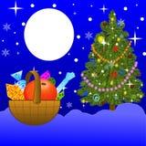 Petit panier avec des cadeaux dessus à neiger dans-champ Image libre de droits