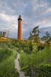Petit phare de point de sable. Image stock