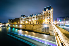 The Petit Pont and buildings along the Seine at night, in Paris, Royalty Free Stock Photos