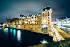 The Petit Pont and buildings along the Seine at night, in Paris, Stock Photos