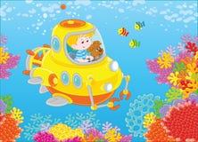 Petit sous-marinier sur un récif Image libre de droits