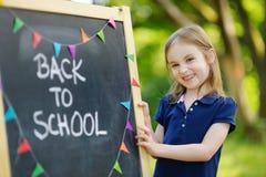 Petite écolière extrêmement enthousiaste Image stock