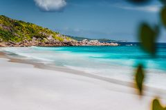 Petite Anse, La Digue in Seychelles. Tropcial, white sand paradise beach with turquise colored water on bright sanny day.  royalty free stock photos