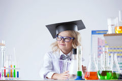 Petite blonde schoolgirl posing in laboratory Stock Photo