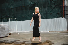 Petite blonde short stature in a big city. Petite blonde short stature in a city Stock Images